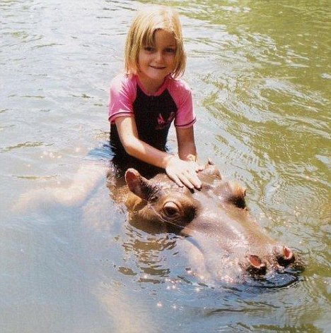 Girl Getting Ride On Hippo