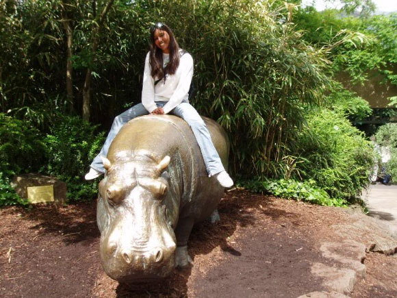 Girl Sitting on a Hippo Statue